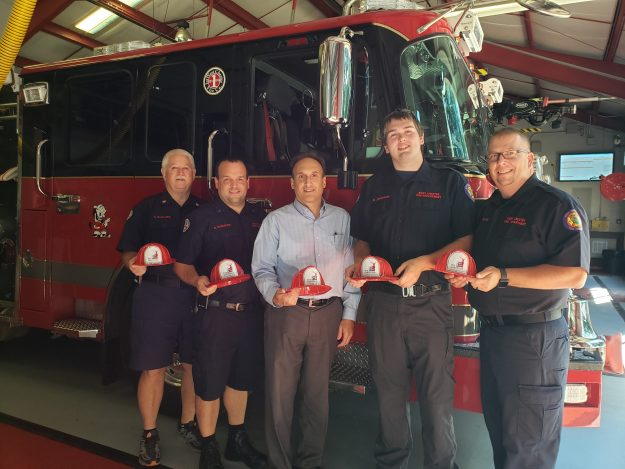 1st West Chester Firefighters receive donation of children's fire hats from Arthur Hall Insurance