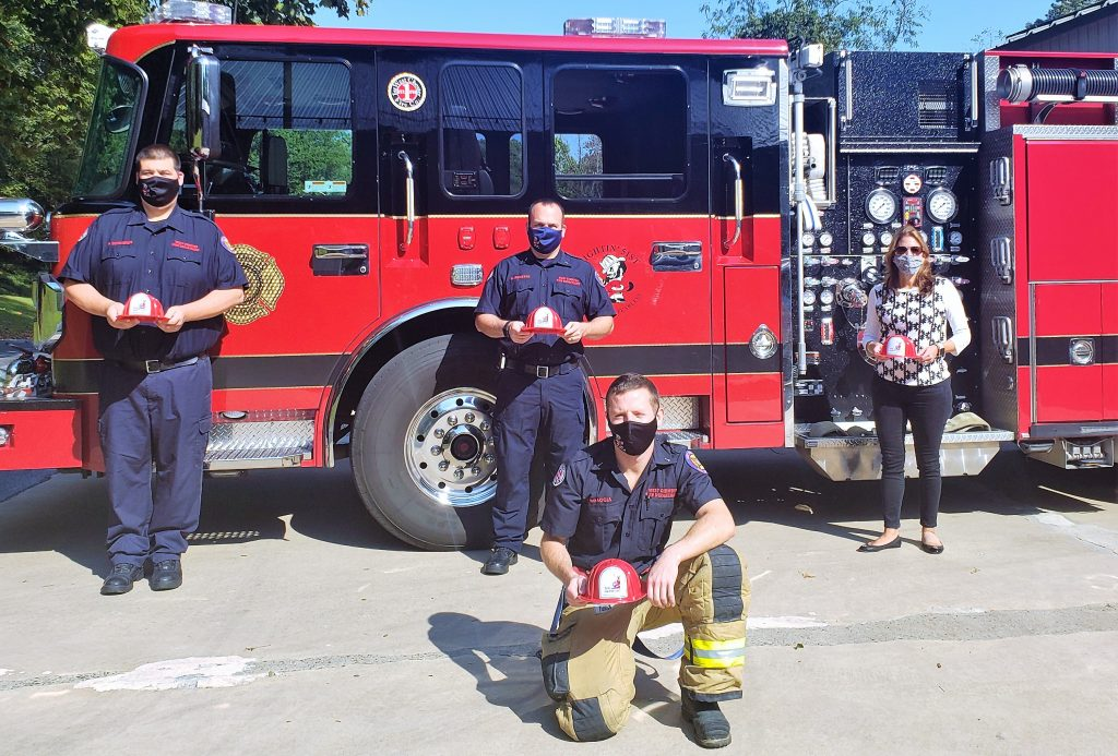 photo Station 51 fire engine with fire fightersa nd Arthur Hall VP